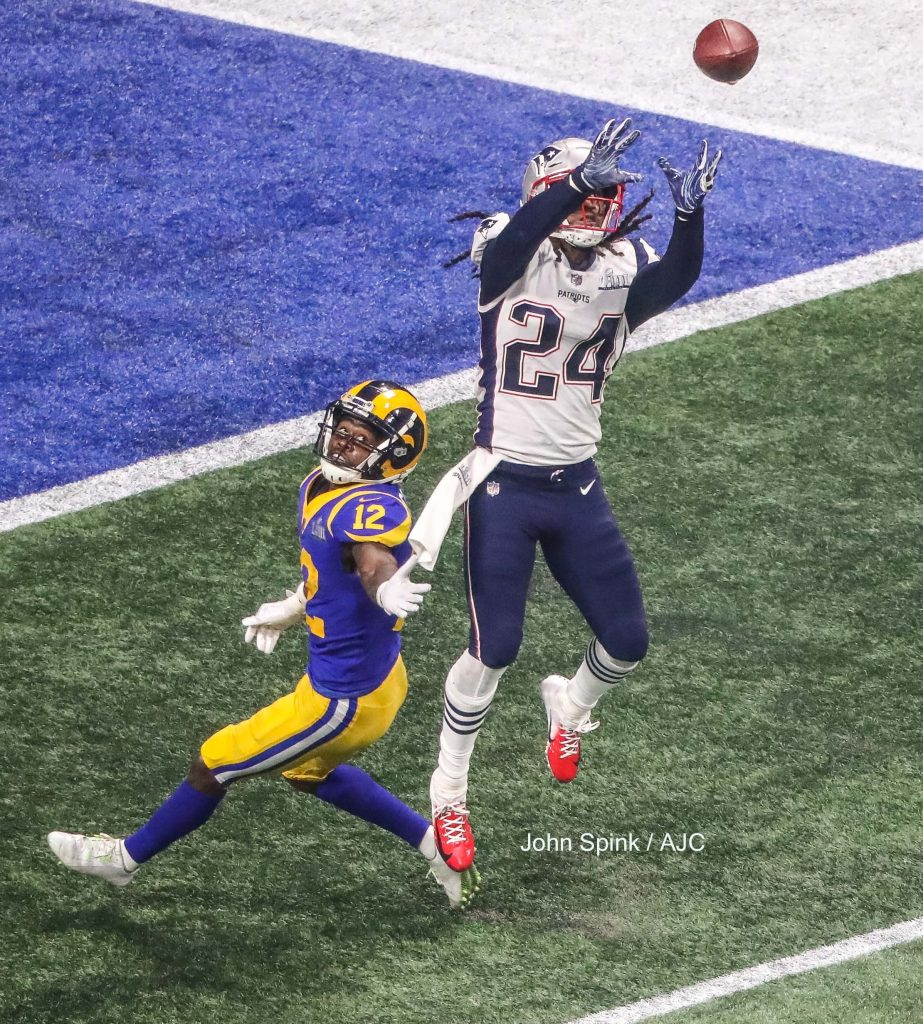 John Spink/Atlanta Journal-Constitution - New England Patriots cornerback Stephon Gilmore (24) gets an interception in the fourth quarter.
