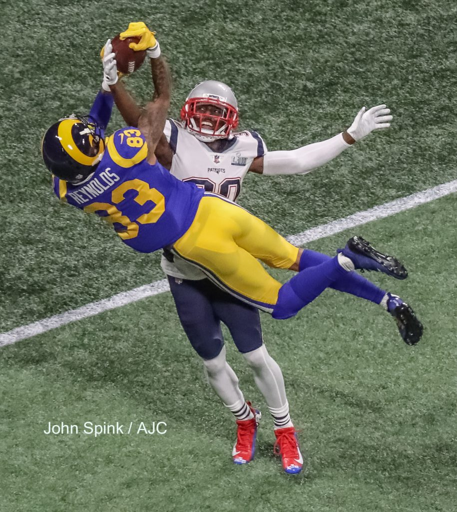 John Spink/Atlanta Journal-Constitution - Los Angeles Rams wide receiver Josh Reynolds (83)(left) can't hold onto a pass as New England Patriots cornerback Jason McCourty (30) knocks it out of his hands during 2nd quarter action.