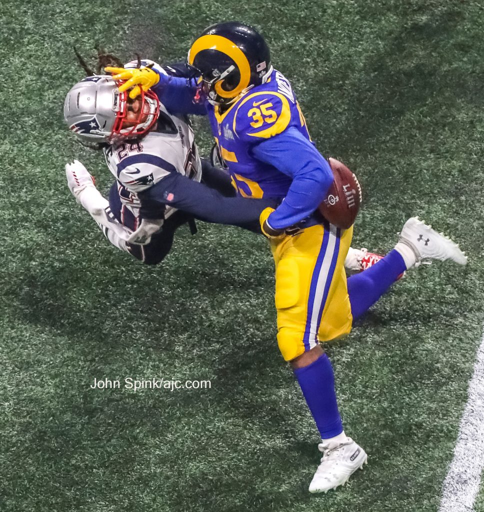 John Spink/Atlanta Journal-Constitution - New England Patriots cornerback Stephon Gilmore (24) gets a stiff arm from Los Angeles  Rams running back C.J. Anderson (35) in the fourth quarter.